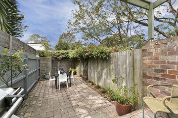 private green, level fenced yard with sitting arrangement