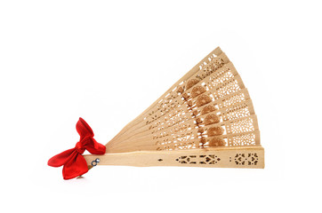 Sandal wood fan with red gift bow isolate on white