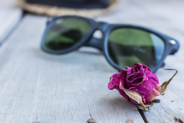 Dried roses and sunglasses