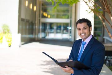 Portrait happy, smiling business man outdoors