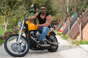 Bodybuilder And Motorcycle