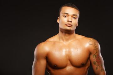 Handsome boxer posing on dark background