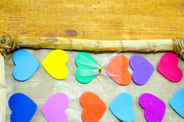 Bunch of colorful hearts in a picture frame