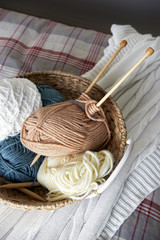 Knitting tools basket on bed,close up