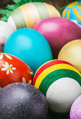Colorful easter eggs in a wooden plate