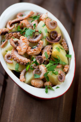 Close-up of traditional italian octopus salad, high angle view
