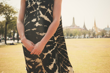 Young woman in park by palace