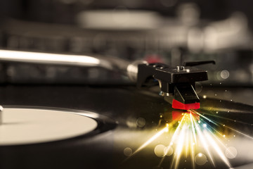 Music player playing vinyl with glow lines comming from the need
