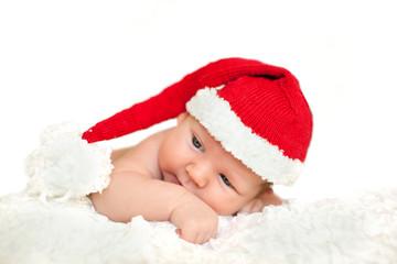 Christmas newborn baby in santa hat. Winter child on winter whit