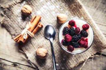 Healthy breakfast - Dairy yogurt with raspberry, mulberry