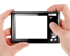 Hand holding a compact digital camera with empty LCD screen