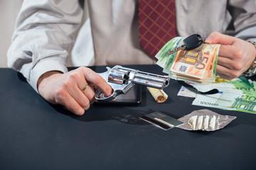 Loan shark with gun, money, drugs