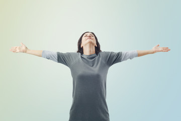 Free and happy woman on sky background