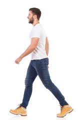 Man walking in jeans and white t-shirt