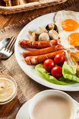 English breakfast with sausage