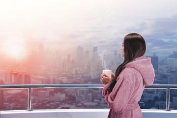 Woman on the balcony enjoying city view