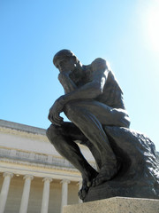 Side front profile of the masterpiece the Thinker by Rodin