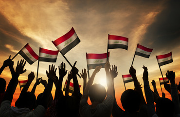 Silhouettes People Waving Flag Iraq Concept