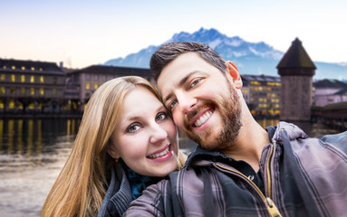Beautiful Couple taking a selfie photo in Lucerne, Switzerland
