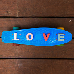 word love on the blue penny board