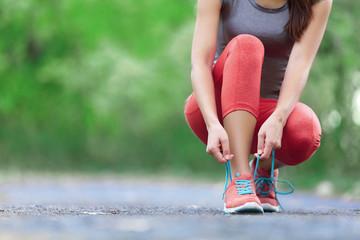 Running shoes - closeup of woman tying shoe laces