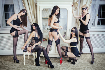 Room full of sexy woman in lingerie