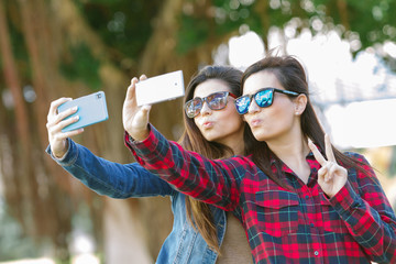 Happy girls taking a Selfie
