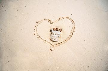 Heart on sand beach.