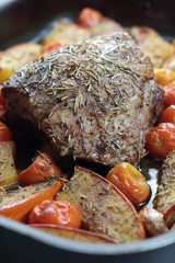 Roasted pork with pumpkin, garlic and tomatoes.