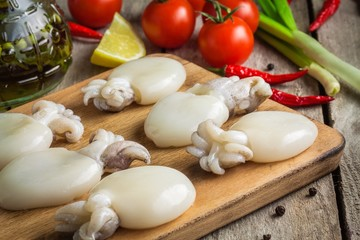 Raw babies cuttlefish  on a cutting board