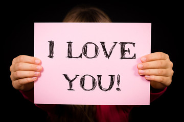 Child holding I Love You sign