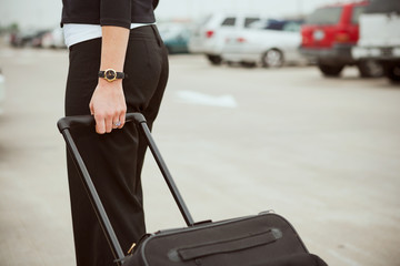 Travel: Pulling Suitcase Through Parking Lot