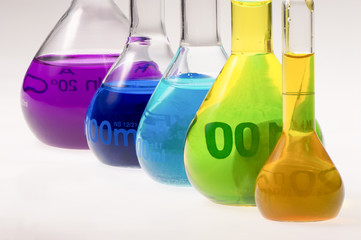 multicolored chemical flasks awaiting analysis