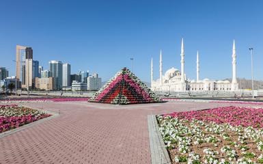 Flower pyramid and Grand Mosque in Fujairah, UAE