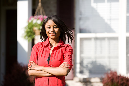Home: Cheerful Woman Outside of Home
