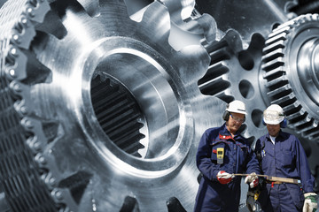 Wall Mural - engineers, workers with giant cogwheels powered by chains