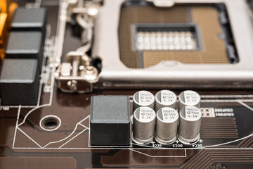 Capacitor And Electronic Components On Computer Motherboard
