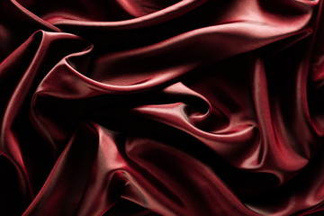 Abstract wave textile texture or background in marsala color