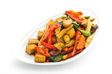Fried vegetables Thai style on white plate