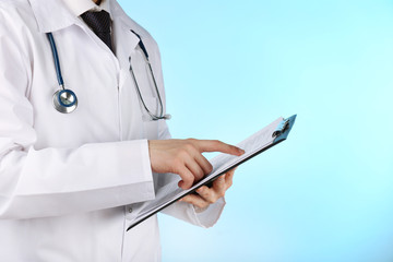 Doctor working with documents on blue background