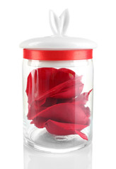 Rose petals in glass jar isolated on white
