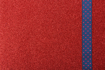 red and blue background with paper tape crosses