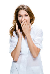 Surprised happy young woman puts her hands over her mouth