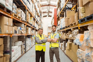 Warehouse team standing with arms crossed