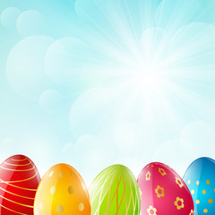 Easter eggs on sunny background