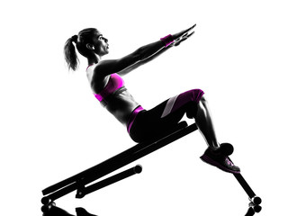 Fototapete - woman fitness  bench press crunches exercises silhouette