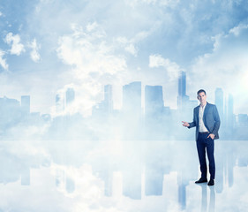 Businessman on modern city background