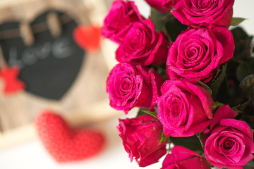 decoration with pink roses, heart, love sign with the inscriptio