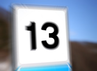 13 in a road sign in mountain