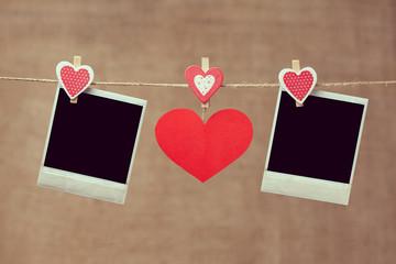 Two polaroid photo frames and red heart for valentines day on vi